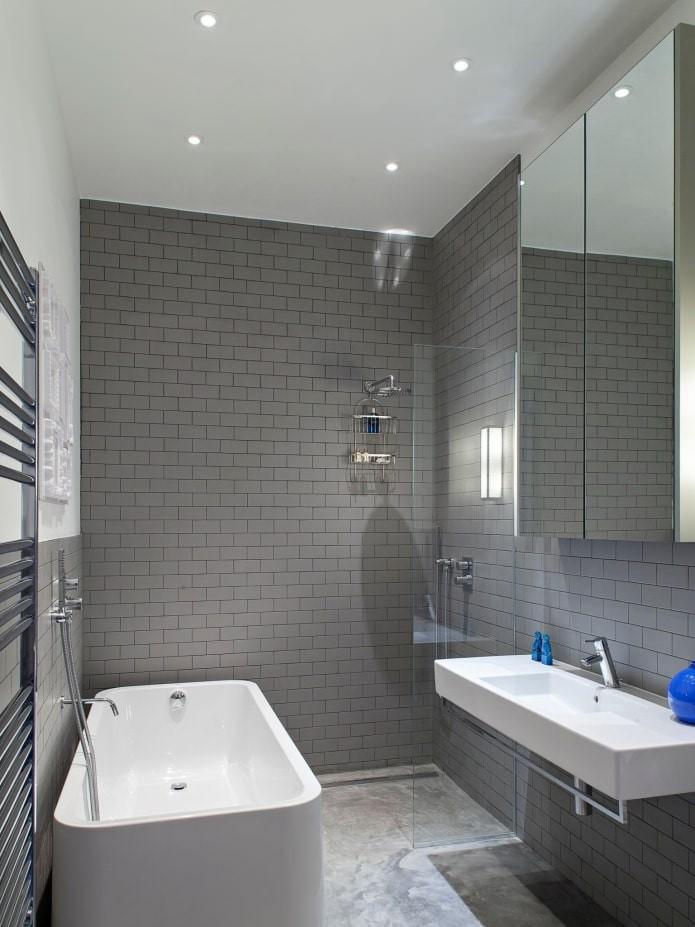 Оформление ванной комнаты серой плиткой: стили, сочетания, мебель